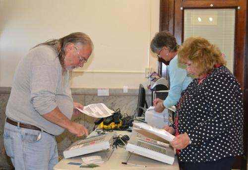 Huntington County Election Board members (from left) Marvin McNew, Lori Guy and Kittie Keiffer run a test of voting machines on Wednesday, Sept. 26, to make sure they're ready for the Nov. 6 general election.