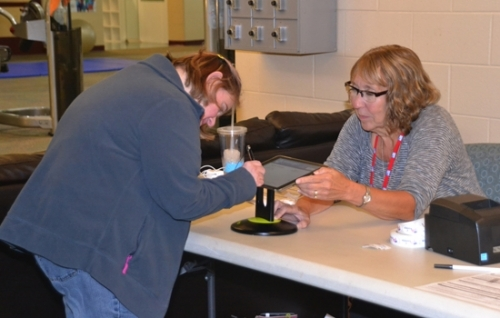 Michelle Duncan (left) signs in before casting her vote on Thursday, Nov. 3, at the Parkview Huntington Family YMCA as poll worker Candy Moore assists. Early voting ends today, Monday, Nov. 7, at noon, with Election Day voting taking place on Tuesday, Nov. 8, from 6 a.m. to 6 p.m. at six locations around the county.
