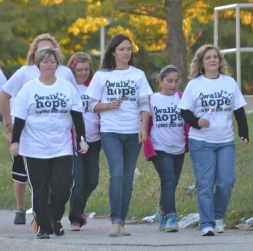 Participants in the fourth annual Walk for Hope walk down MacGahan Street at the beginning of a two-mile loop, starting and ending at Huntington North High School, to raise awareness of and raise funds to prevent youth suicide in Huntington County.