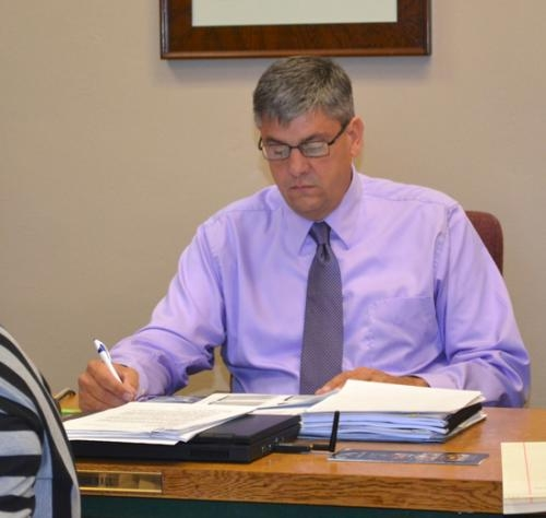 "Huntington County Commissioner Tom Wall, seen during the Oct. 8 commissioners' meeting, says misdemeanor battery charges filed against him are ""untrue."" He says he will continue to serve as commissioner and continue his campaign for re-election."