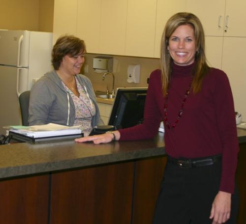 Dr. Amy Welker (right) stands at the nurses' station with Kellie Syndram (left), a nurse, at her new practice in the Roanoke Professional Center on the practice's opening day on Monday, Dec. 13.
