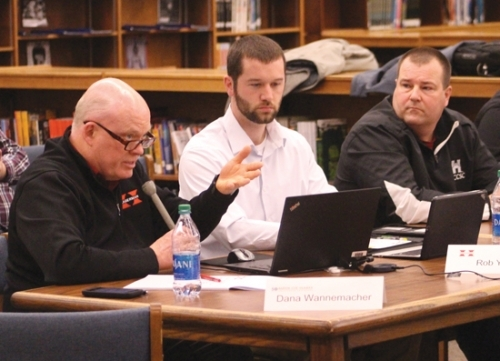 Rob Young (left), vice president of business development for The Hagerman Group, speaks about how his construction firm would address the heating, ventilation and air conditioning needs at Huntington North High School during a special public work session of the Huntington County Community School Corporation Board of Trustees on Saturday, Jan. 18, in the Huntington North Library. The meeting was convened to discuss the facility issues at Huntington North, which range from a leaking roof to decaying wastewater infrastructure.
