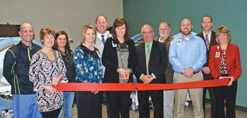 Parkview Huntington Hospital President Juli Johnson (center) prepares to cut the ribbon for the Parkview Huntington Hospital Center for Wound Healing at an event in December. Joining her to celebrate the opening are (from left) Todd Sider, MD, who will provide care at the center; Darlene Stanley, member, PHH Board of Directors; Susan Zahn, member, PHH Board of Directors; Amy Rosen, clinical program director for the center; John Nelson, member, PHH Board of Directors; Johnson; Ryan Warner, chair, PHH Board of Directors; James Edlund, medical director for the center; Doug Selig, vice president, Patient Care Services, PHH; Jeremy Nix, chair, Parkview Huntington Foundation Board of Directors; and Sonya Foraker, manager, Finance, PHH.