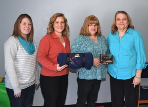 DeAnn Wohlgemuth (third from left) has been named Adult Volunteer of the Year by the Youth Services Bureau of Huntington County.