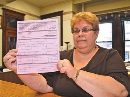 Huntington County Auditor Cindy Yeiter displays the homestead verification form that was mailed out this month to approximately 1,850 Huntington County homeowners. The forms must be returned by the end of the year.
