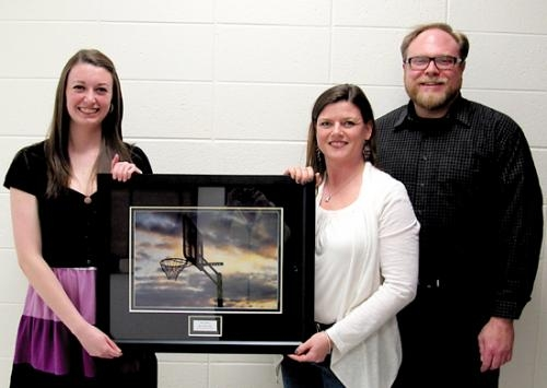 Heather Malone (second from left), president of the Chi Chapter of Tri Kappa, holds the recipient of the sorority's 2013 Youth Art Award. Huntington North High School senior Sarah Johnson (first from left) was this year's winner.