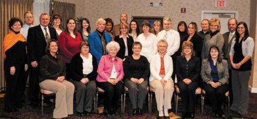 Employees of iAB financial bank celebrate their service anniversaries at an all employee meeting.