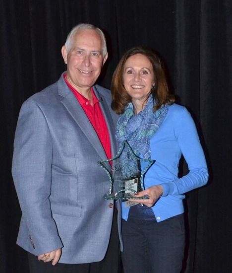 Karen J. Cameron (right), iAB financial bank executive vice president, accepts the 5 Star Member Award from S. Joe DeHaven, IBA president and chief executive officer.