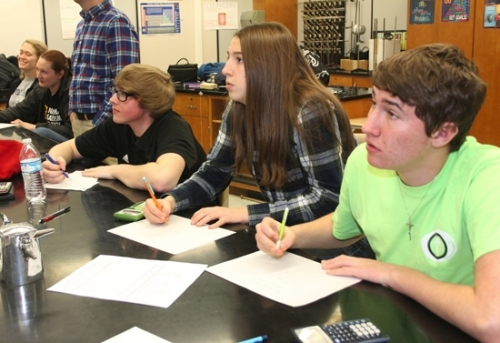 Intently focused on a question projected on a screen, Huntington North High School Academic Super Bowl team members (from left) Bethany Williams, Emma Gordon, Charles Grey, Audrey Marjamaa and Zach Lippe get ready to write the answer down before the time limit expires during a practice session on Feb. 29. The team went on to place in the social studies, math and English sections of the multi-school competition held on March 2.