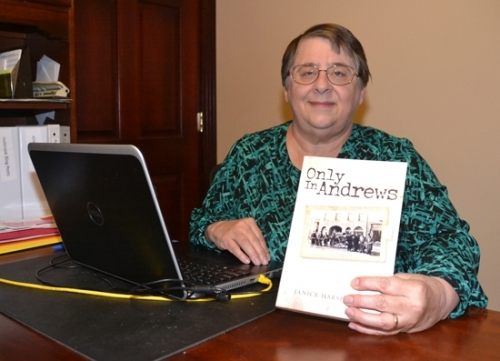 "Janice Harshbarger displays a copy of her recently published book, ""Only in Andrews,"" which recounts the early history of the Huntington County community."