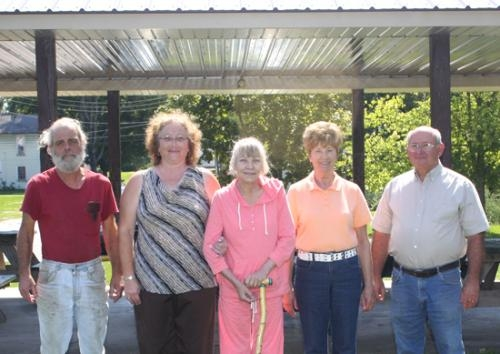 Standing outside the park pavilion in Andrews are (from left) park team members Rick Wright, CJ Rohler, park liaison Linda Wright, Shirley Fisher and John Harshbarger.