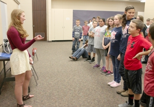 Huntington North High School senior Molly Smith (left) talks to fifth-grade students at Lancaster Elementary School during a convocation held Monday, May 16, about how to deal with bullies. Smith used lessons from her own life experiences to teach the students how to recognize bullying, make friends with kids who bully and develop their own self-confidence.