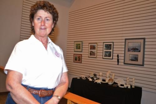 Brenda Knepper stands with some of the carved ivory collected by her late aunt, Cosette Sheets. The collection is on temporary exhibit at the Sheets Wildlife Museum, where wildlife taken by Sheets' brother, Sumner Sheets, is showcased.