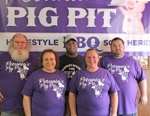 Members of the Petunia's Pig Pit crew who are organizing the Huntington BBQ Fest are (front row from left) Brenda Rosen and Sabrina Newcomb; and (back row from left) Larry Rosen Jr., Dennis Newcomb and Norm Sisemore. The barbecue contest event takes place Aug. 25 at the Huntington County Fairgrounds.