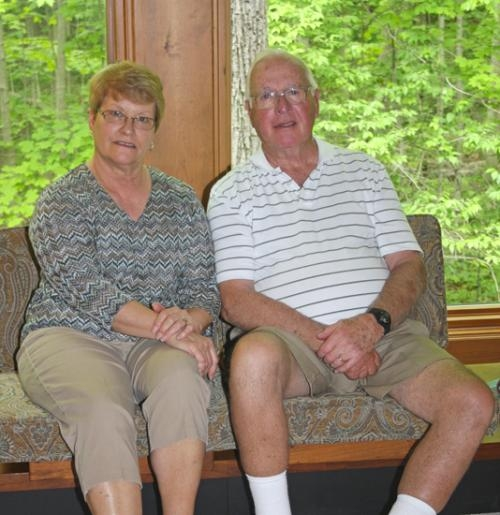 Sue (left) and John Jepsen sit together in their home in Huntington. John Jepsen survived cardiac arrest in March.
