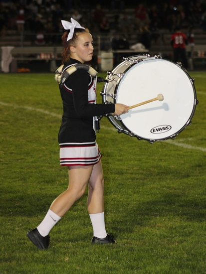 Callista Barker, a member of both the Huntington North High School cheerleading squad and marching band, performs with the band while clad in her cheerleading attire during halftime of the school's homecoming football game on Friday, Sept. 25.