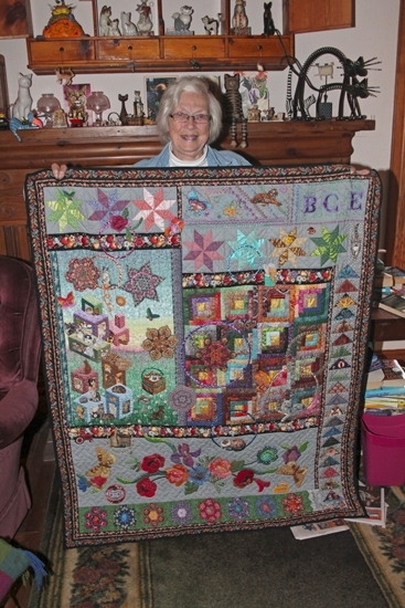 """Bernice Enyeart holds her favorite quilt, named """"BCE"""" for her initials, at her home in rural Huntington. Enyeart, who has won numerous awards for her innovative quilts, has made 79 quilts and wall hangings and still has 60 of them."""
