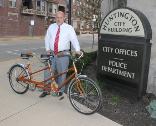 Huntington Mayor Brooks Fetters stands outside the Huntington City Building with his 1968 Schwinn tandem bicycle, which he rode to work that day.