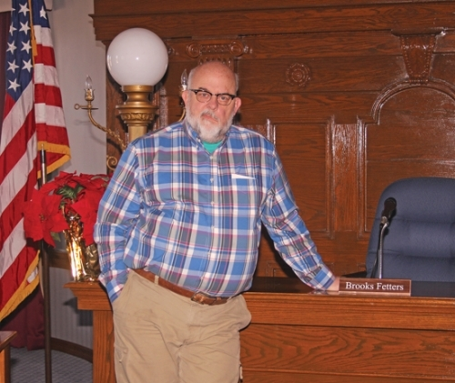 Huntington Mayor Brooks Fetters stands by his seat in the Huntington Common Council chambers on Dec. 18. As he leaves the mayor's office, Fetters says he does so with great pride over his administration's accomplishments over the past eight years.