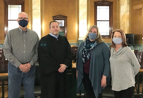 The first two volunteers for the Youth Services Bureau's Court Appointed Special Advocate (CASA) program have officially been sworn in. Featured (from left) are CASA volunteer Charlie Chapman, Circuit Court Judge Davin Smith, CASA volunteer Terra Rowley and Program Coordinator Tamie Morrison.