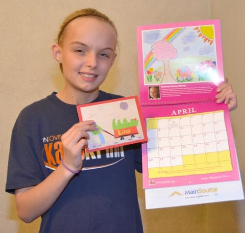 Dalaney Vickrey displays the Christmas card and calendar page she designed for Riley Hospital for Children.