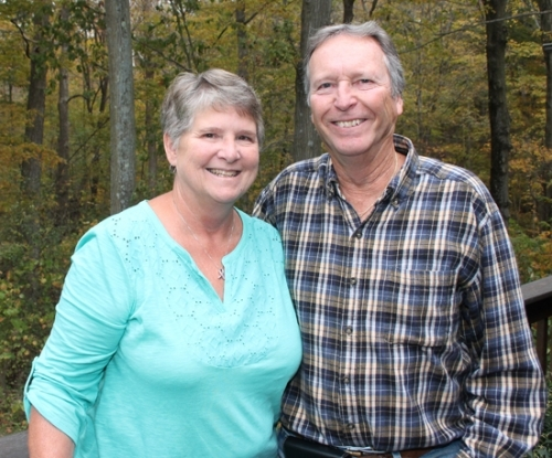 Kathy Carnes (left), a breast cancer survivor, and her husband, Ron, enjoy the view outside their Huntington home. She recently marked a year since she has been cancer free. Ron Carnes was named the 2017 Caregiver of the Year by the Huntington Relay for Life for his efforts in helping his wife beat the disease.