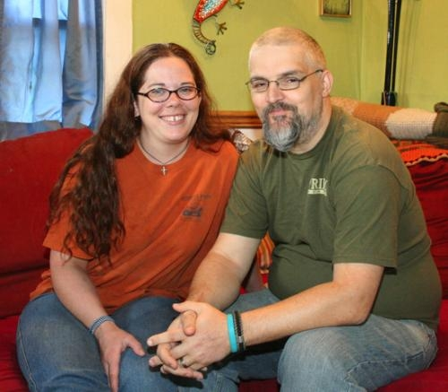Elisabeth and Chad Johnson, of Huntington, are planning a hog roast fund-raiser to help defray expenses following a kidney transplant for Chad.