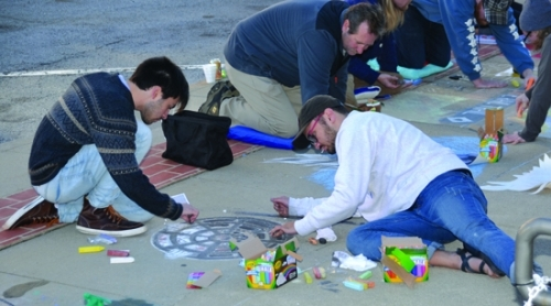 Christian Garver (left) and Joshua Matos work on a chalk drawing on the sidewalk outside the Huntington County Courthouse last year during Huntington's first Chalk Walk. The event returns on Sept. 15, from 1 p.m. to 5 p.m.