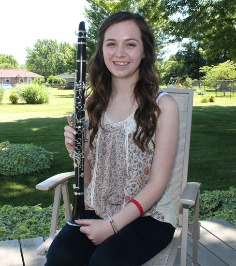 Maitlyn Christman relaxes in the backyard of her Huntington home, holding her clarinet. The 14-year-old won an audition to play in the Honors Performance Series at Carnegie Hall in June.
