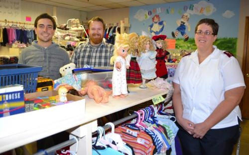 Kyle Miller and Joey Spiegel, both of Love INC, and Salvation Army Capt. Barbara McCauley (from left) are working together to make some changes in the Christmas assistance program in Huntington County.