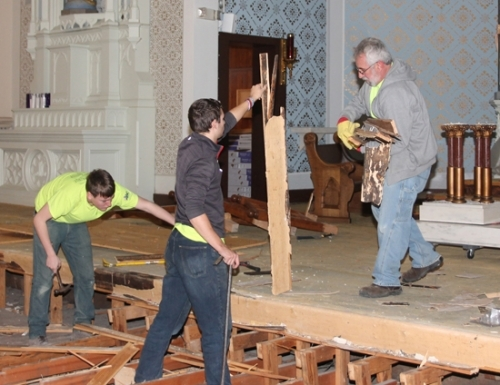 Workers with the Fort Wayne-based Jack Laurie Group work on removing the steps leading to the sanctuary dais of SS. Peter and Paul Catholic Church on Wednesday, Nov. 28. The first phase of renovations at the church are expected to be completed by Dec. 14.