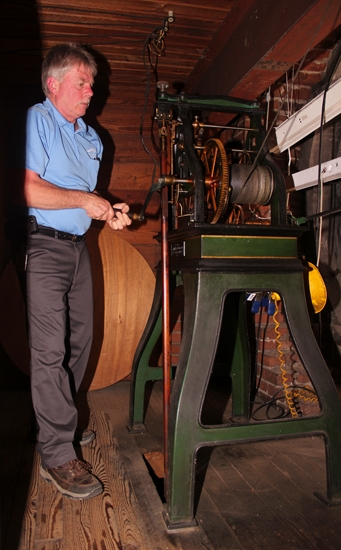 Greg Ricker, facilities manager of the Huntington County Courthouse, cranks one of the building's four exterior clocks on Tuesday, April 25. The clocks, which require cranking once a week in order to function, have been in continuous use since they were installed in the courthouse in 1907.