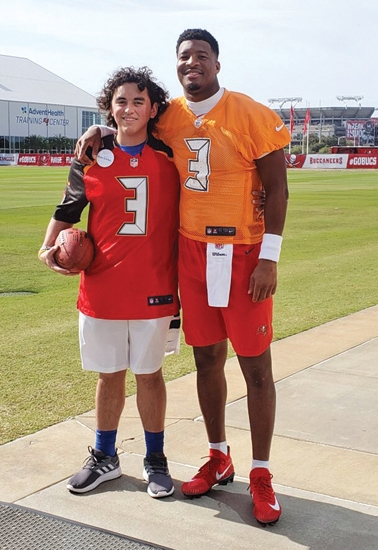 Conner West (left), of Huntington, stands with Jameis Winston, the starting quarterback for the Tampa Bay Buccaneers in the National Football League, on Dec. 28 last year in Tampa, FL. West got to meet Winston, his favorite athlete, through the Make-A-Wish Foundation, which granted West a wish after he was diagnosed with leukemia in 2016. West is now cancer-free.