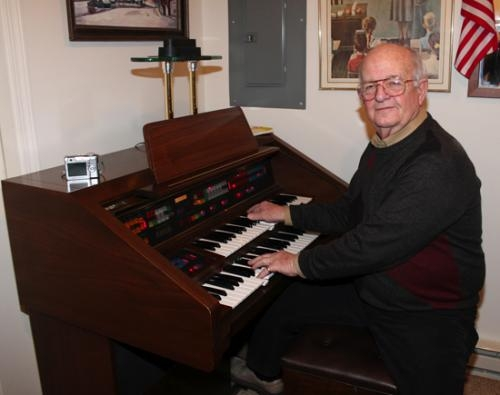 Bill Couch, of Warren, plays the organ in his office. It's one of his hobbies in a busy life that's seen him serve as a school superintendent, the CEO of a company and as a manager for Habitat for Humanity.