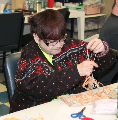 Marsha Sommers works on a needlework project in the new Pathfinder Services Inc. Creative Abilities studio, located at Café of Hope, 900 E. State St., Huntington. The Creative Abilities artists have been working out of their new home, which also features a gallery store, since Nov. 1.