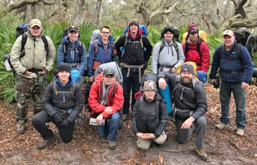 Using a break to take a group photo, members of Boy Scout Troop 130 record their time visiting the wilds of Cumberland Island National Seashore between Christmas and New Year's Day. Pictured (kneeling, from left) are Jackson Lunsford, Jacob Worsham, Jamison Heyde and Justin Lunsford; and (standing, from left) Nick Anderson, Breckin Hammel, Jacob Bruce, Kevin King, Isaac Gordon, Brendan Brinkman and Brad Gordon. Not pictured is Assistant Scoutmaster Jeff Webb.