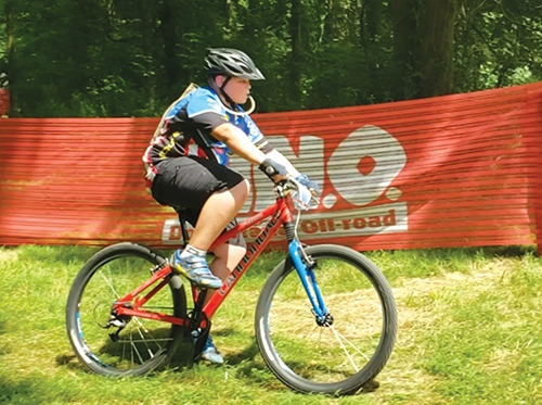 Competing in a DINO bicycling event is 13-year-old Wyatt Doctor, of Huntington. The competition was held at Potato Creek State Park on Sunday, July 26.