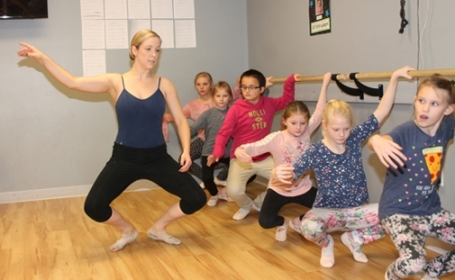 Joy Hersey (left) takes her ballet class students at the Parkview Boys & Girls Club of Huntington County through a move at the barre on Monday, Nov. 6, in preparation for the troupe's upcoming Christmas performance. Her students include (from left) Esther Michelle Messenger, 10; Avorie Monroe, 11; Alexis Smith, 10; Adreonna Monroe, 9; Kimora Bradin, 9; and Savannah Tyler, 9.