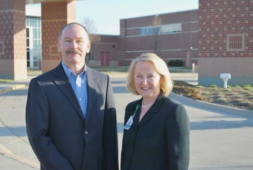 Rick Baker (left), chairman of the Parkview Huntington Hospital board of directors, and Darlene Garrett, chief operating officer of Parkview Huntington Hospital, stand in front of the 10-year-old Parkview Huntington Hospital building on Stults Road.