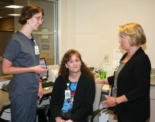 Parkview Huntington Hospital's retiring chief operations officer, Darlene Garrett (right) chats with ultrasound technologist Hannah Wyatt (left) and receptionist Leigh Ann Jones in the office area of the hospital's radiology diagnostics department.