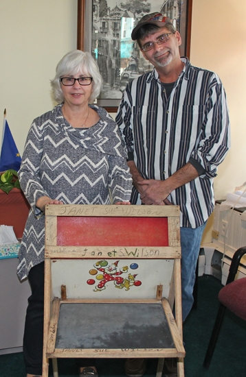 Janet McElhaney (left) thanks Scott Scheiber for finding and returning her childhood desk, after they met on Dec. 28. Scheiber found the desk, which was lost for more than 60 years, in a furnace room he was cleaning out and decided to find its original owner.