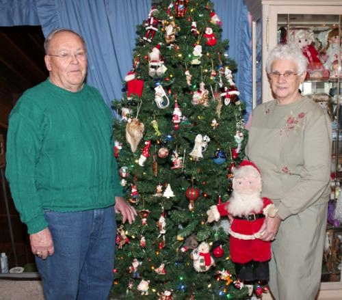 Jim and Rita Dinius, of Huntington, stand in front of their Christmas tree, which showcases 200 Santa Claus ornaments. The Diniuses have a collection of approximately 400 pieces of Santa Claus memorabilia, which they've been collecting since the 1990s.