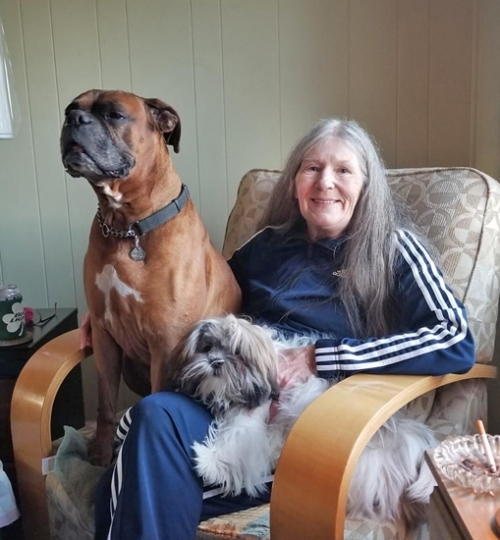 Sue-Ellen Sommers, of Andrews, poses with her dogs Buck (left) and Scruffy. She and her husband, Terry, recently lost Buck when he developed severe seizures.