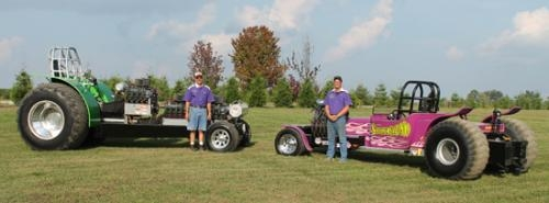 Mike Schoenemann (left) and his son, Joe, both of Huntington County, stand with the tractor and truck, respectively, that they use in pulling events across various states. The two will compete in the Roanoke Fall Festival's truck and tractor pull.