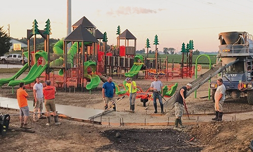 Local volunteers donated their time this summer to install playground equipment and pour sections of the cement walkway for Drake Goetz Memorial Park, located at 4082N-350E in Huntington. The park features a soccer field and pickleball court and will also include playground equipment, a walking path and more.