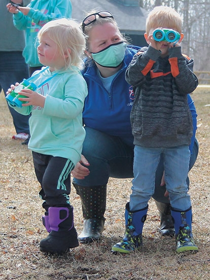 Rebecca (left), Emily (center) and Conrad Day participate in the last Eagle Watch of the year on Saturday, Feb. 27, at Salamonie Lake. These events are put on by Upper Wabash Interpretive Services every year in January and February.