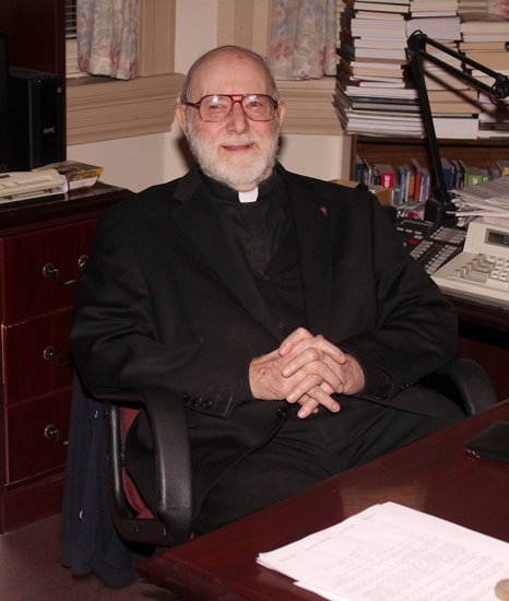 Rev. Ron Rieder, seen seated in his office, has served as the pastor of SS. Peter and Paul Parish, in Huntington, since 1984. His 33-year tenure at the church will be coming to an end next year with his retirement.