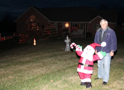 Kent Farthing stands next to some of the displays lit up in his front yard. The display can be viewed through New Year's Day at 1274 Waterworks Rd., Huntington.