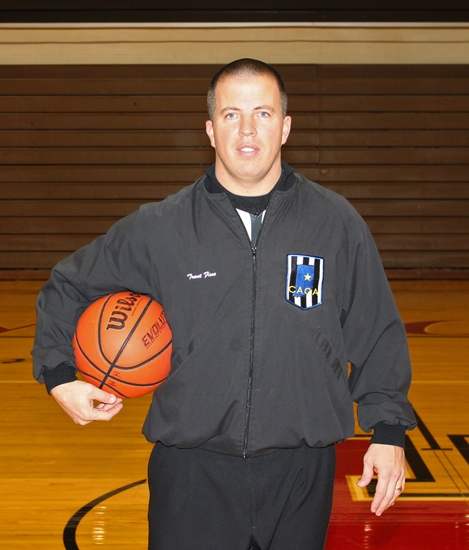 Trent Fine coaches the Huntington North High School football team and also officiates high school basketball games around the state during the winter. This is his 11th season as an official.