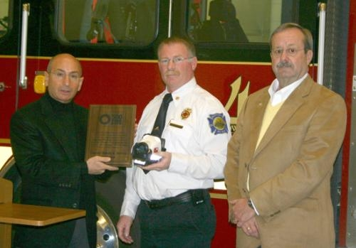 rank Buonanotte (left), founder of 500 For Life, presents a commemorative plaque and a new thermal imaging camera to Huntington Fire Chief Matthew Armstrong (center) and Huntington Mayor Steve Updike at the Southside Fire Station in Huntington on Jan. 21.